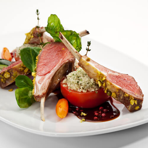 stock-photo-roasted-lamb-chops-with-pistachio-garnished-with-vegetables-and-basil-63248404.jpg