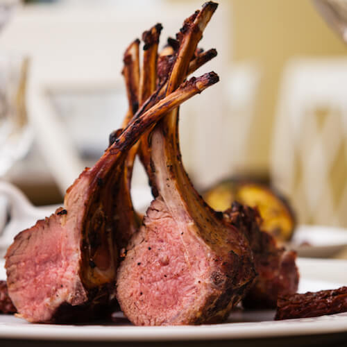 stock-photo-lamb-rack-with-limoncello-glaze-served-on-a-plate-497277970.jpg