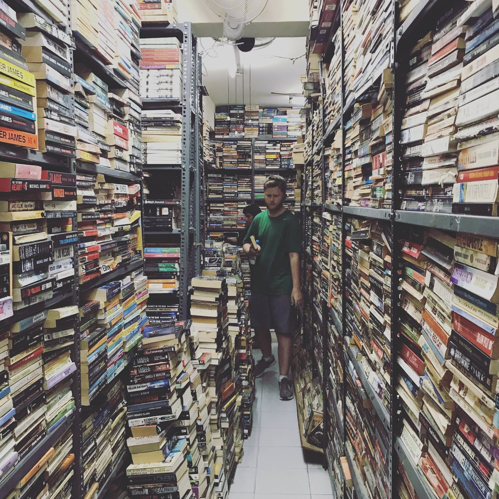 boy hunting for a book at blossom book store in downtown bengaluru