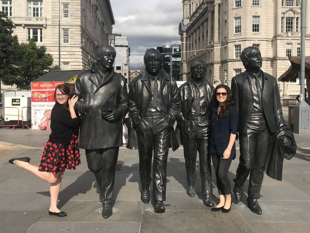 kicking it with our four main men! the beatles statue on the docks.