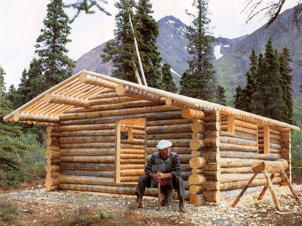 Dick outside his self built cabin