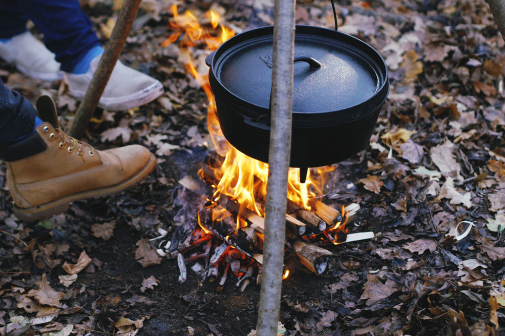 Warming toes as lunch cooks in the dutch oven.