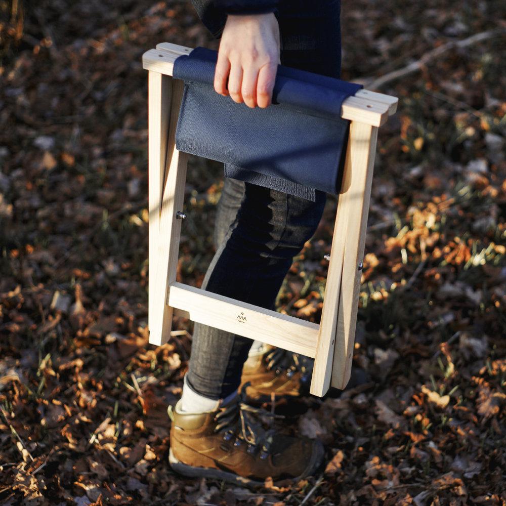 Folding stool, folded.