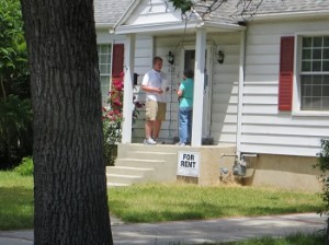 Nathanael and Joyce sharing the gospel at the door of a Mormon.