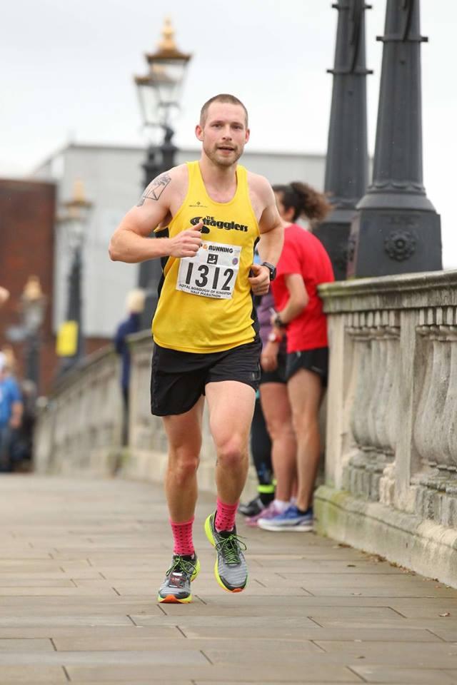 Me, running a half-marathon, smiling.