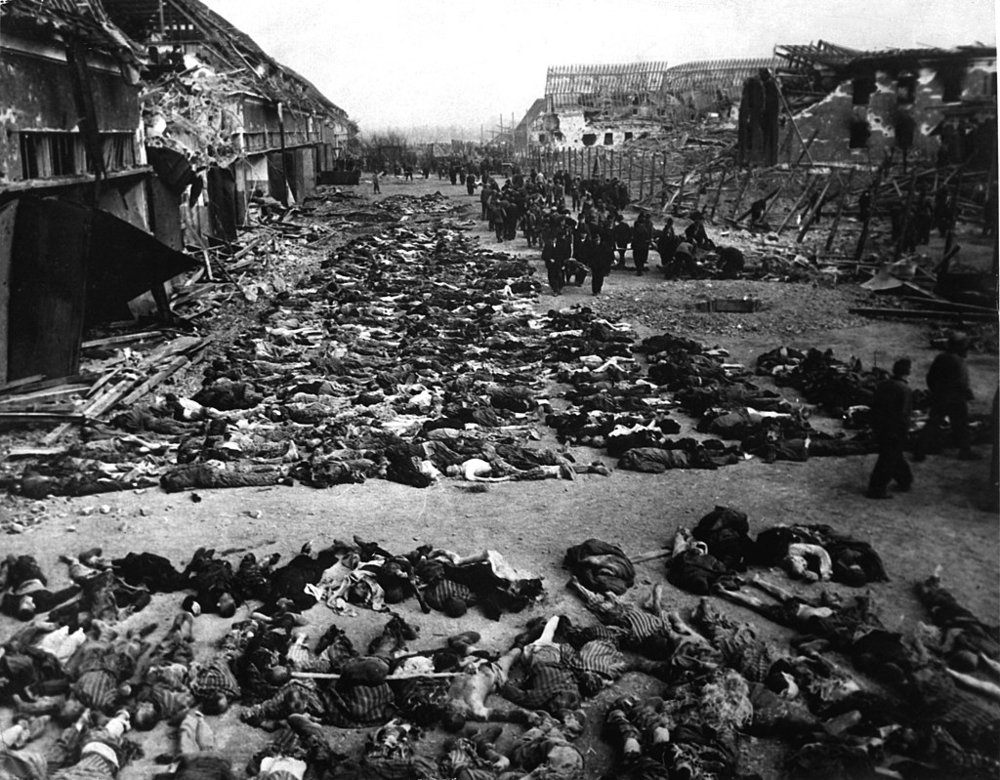 1024px-Corpses_in_the_courtyard_of_Nordhausen_concentration_camp.jpg