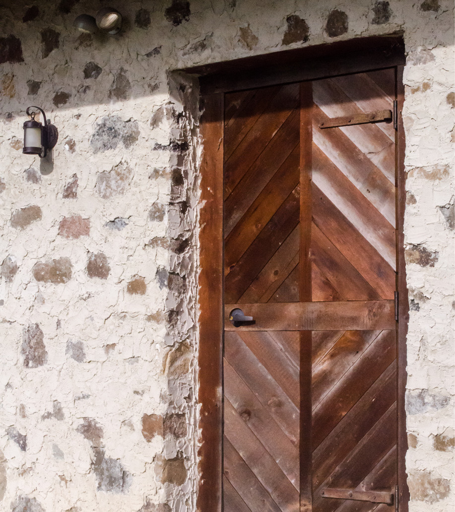 Our repurposed barn features quilt-inspired elements like this patterned door.