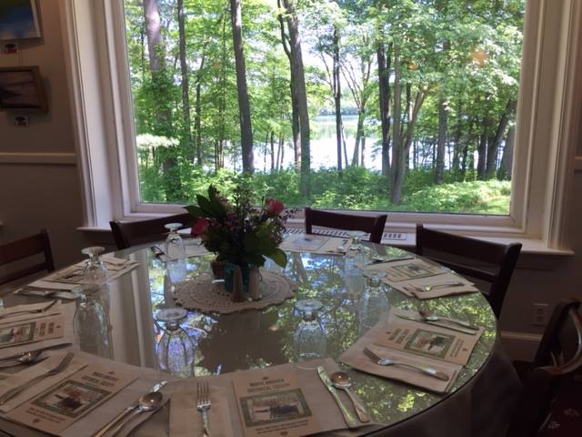 Table Setting for the 2017 Gala overlooking scenic Lake Cochichewick at the historic Rolling Ridge.