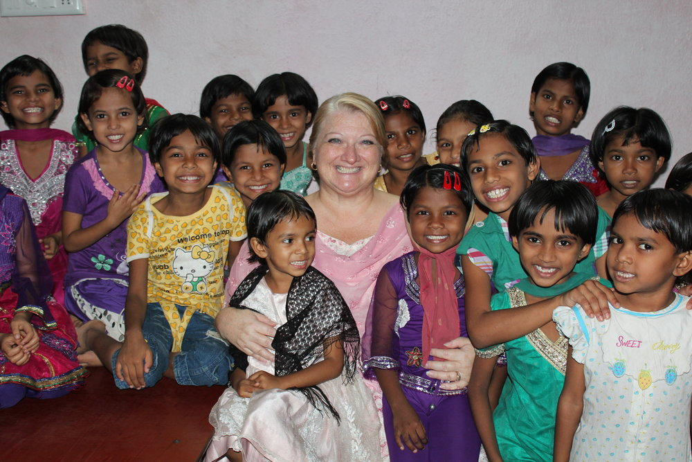 Kim with the girls of our orphanage - Copy.JPG
