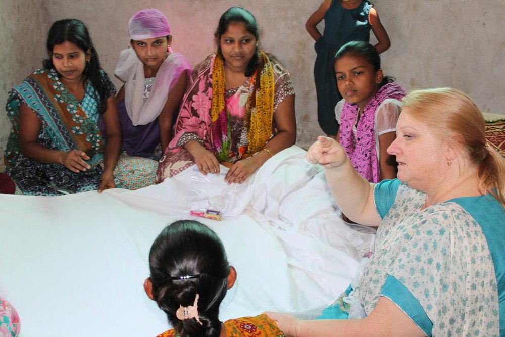 Kim teaching tribal women to sew - Copy.JPG
