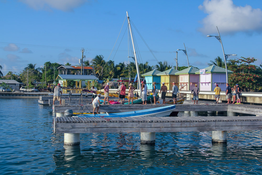 Placencia Dock and local fishing boats.jpg