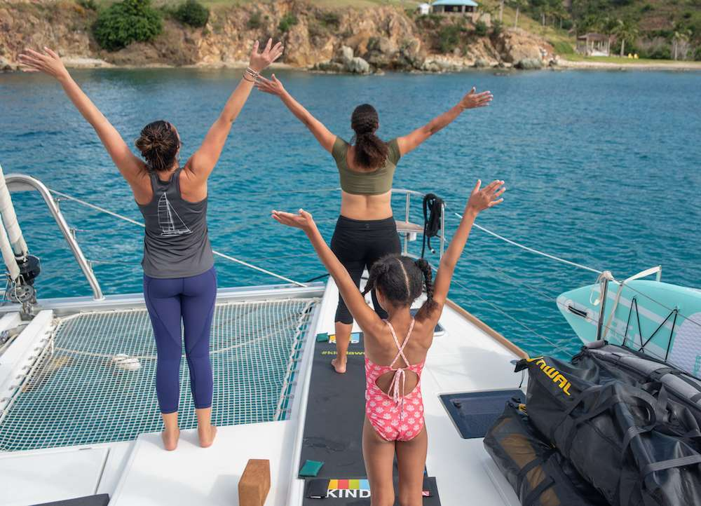 Jill leads yoga for guests aboard Oui Cherie