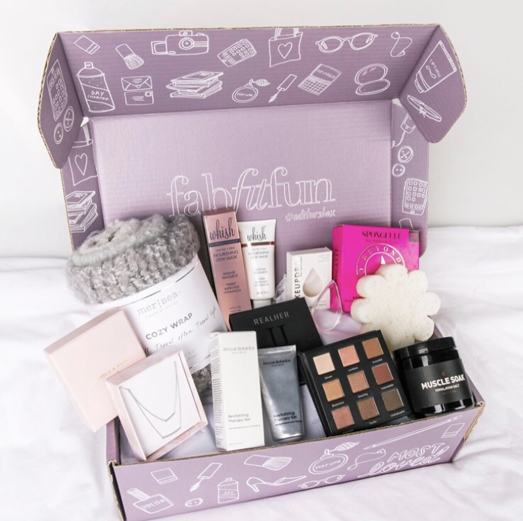 Purple FabFitFun Subscription Box filled with products