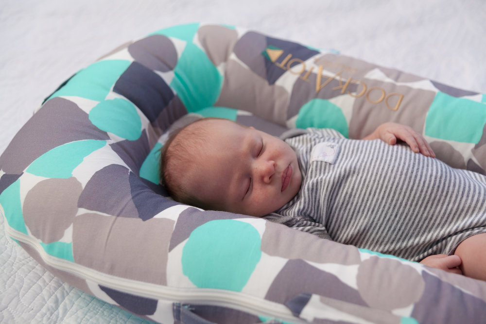 baby sleeping on dockatot without attachments