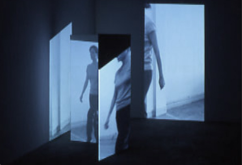 Hallway (Approximation), 00:03:00 minute loop, color, no audio, h 35 x l 45 x w 50 inches, video projection, wood, plastic, vellum