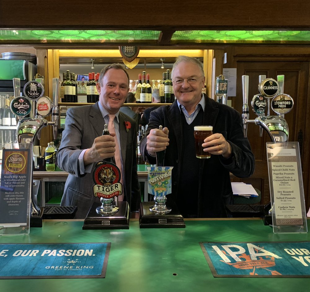 Nick Allen, Director of the West Chiltington-based Greyhound Brewery ( www.greyhoundbrewery.co.uk ), toasting the freeze in beer duty with Nick Herbert in the House of Commons bar this week.