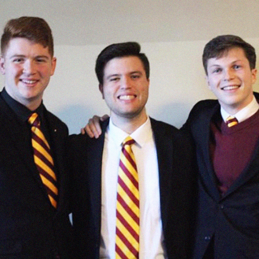 Brother Kyle Bueno (Bridgewater State University, '18) (center).