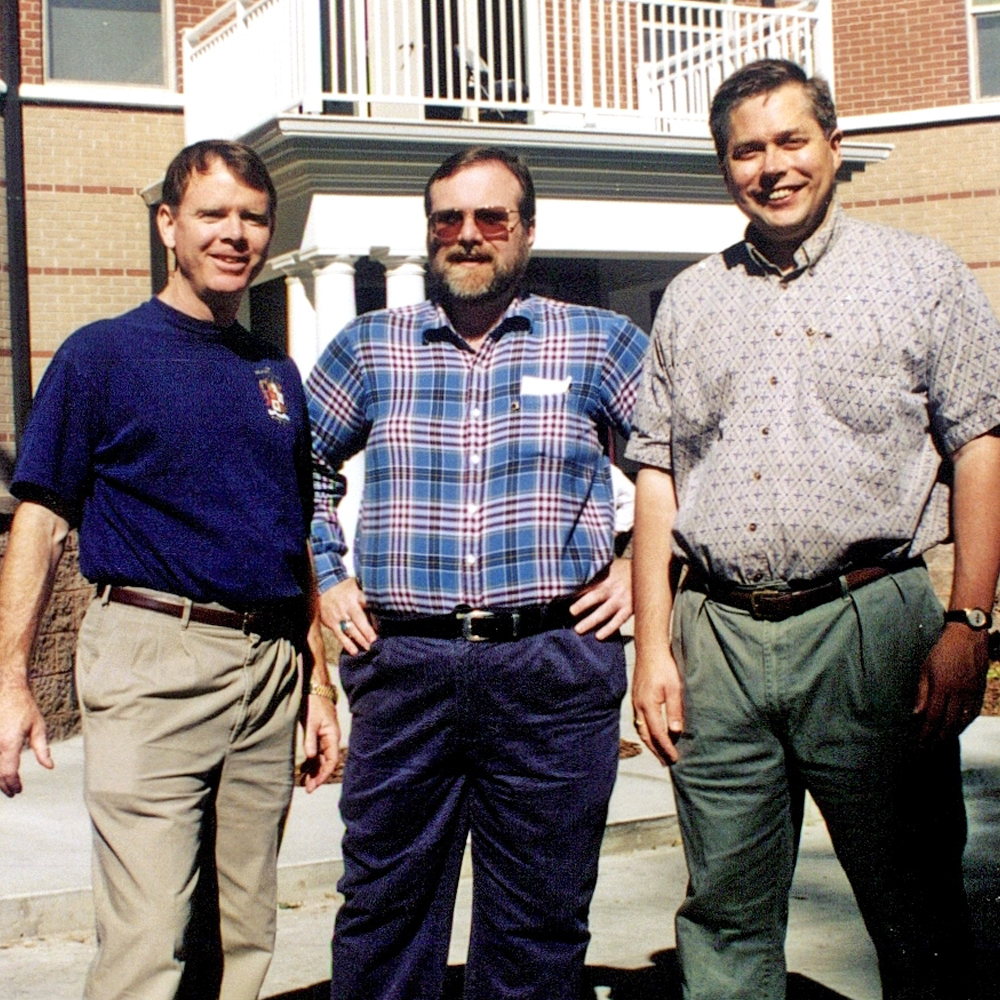 Brother Paul Allen (Washington State University, '75) (center), flanked by Brother Mike Flood (Washington State University, '72) (left) and Brother Bert Kolde (Washington State University, '76) (right) at the WSU Chapter House dedication in 1996.