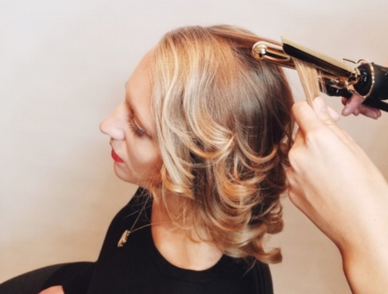 1. Start with a Base - The foundation of your style is key. Take a 1/4 inch curling iron and curl your entire head, with the curls going away from the face. For a looser, wavier effect, use a 1/2 inch or 1 inch curling iron, or if you have naturally textured hair, skip this step all together.