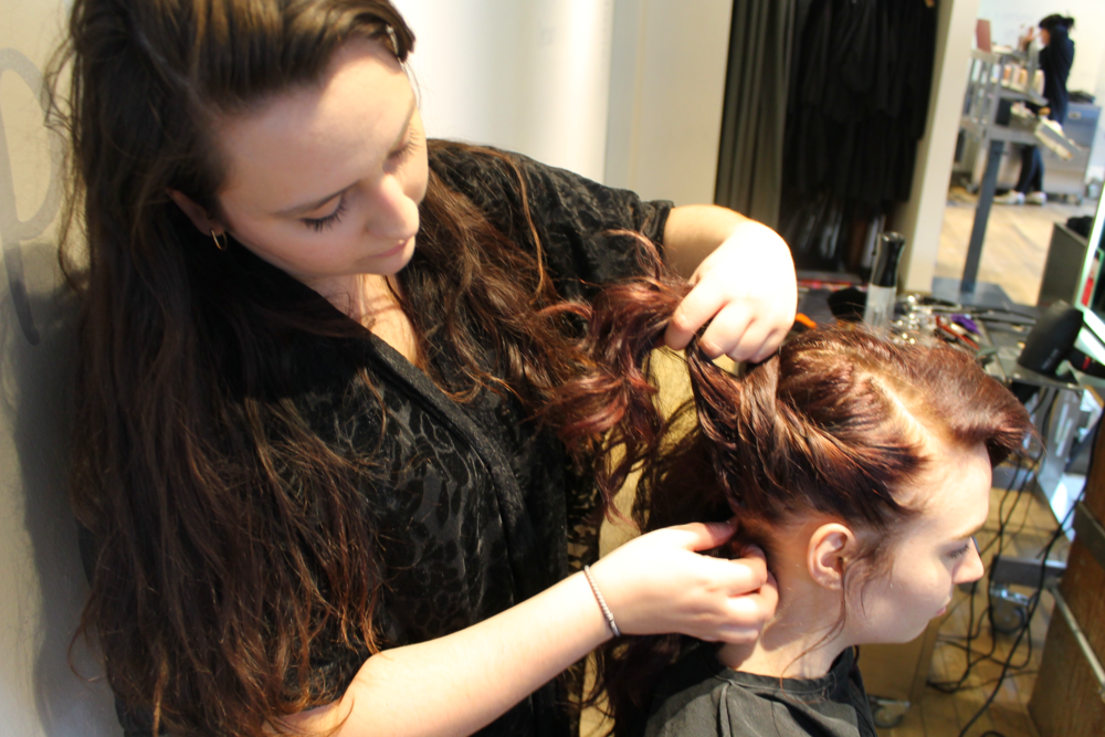 3. Start Braiding - Start a rope braid from the front hairline, picking up hair as you go.