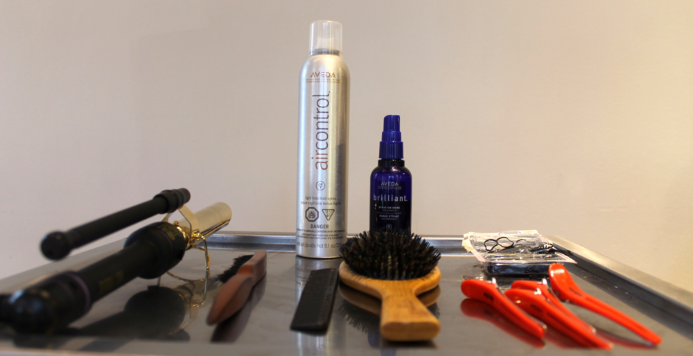 The Tools: Comb, Sectioning clips, Blow-dryer, Curling iron, Mini elastics, Bobby pins, Backcombing brush   The Products:  Volumizing Tonic, Texture Tonic, Air Control, Brilliant Spray-On Shine