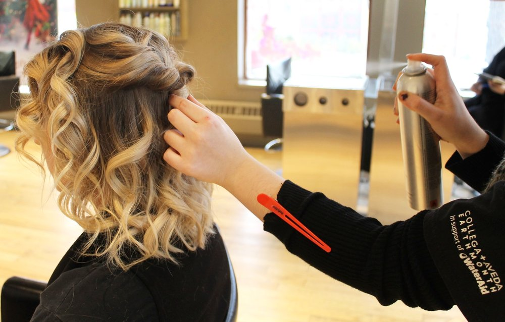 5. Set the Look - Spray the entire look lightly with Air Control Hairspray for extra hold, and then wrap a 1-inch piece of hair around the elastic to conceal it.