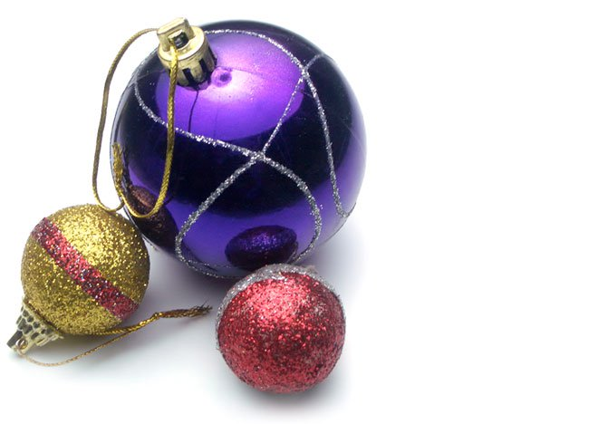 5. Do-It-Yourself Decorating - Gather branches from the backyard, put them in a tall narrow vase, and hang some ornaments fromthem for an easy and modern look.