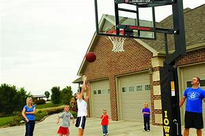 family playing hoops in driveway.jpg