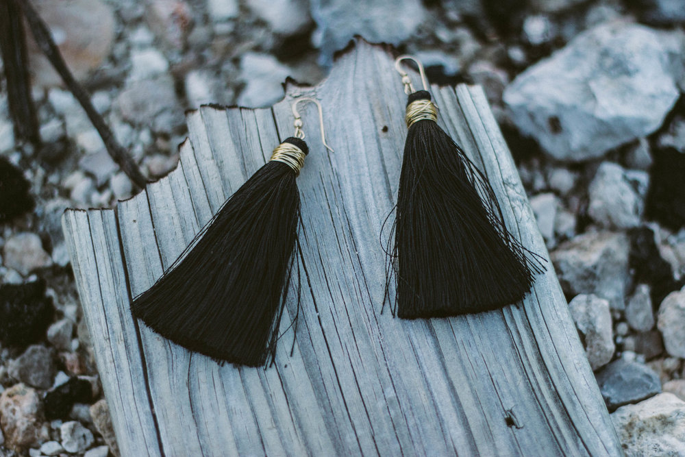 Black tassle earrings with gold mount