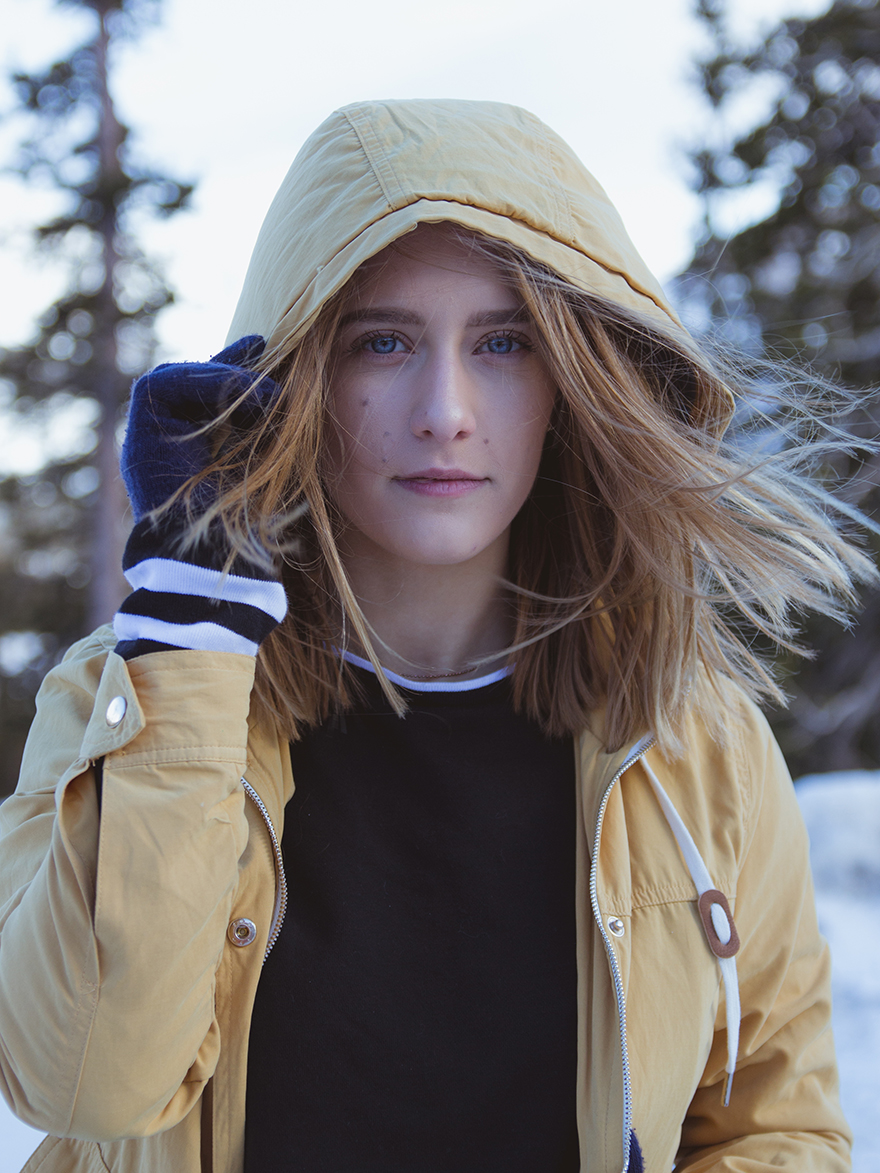 Portrait of girl in yellow jacket in Colorado