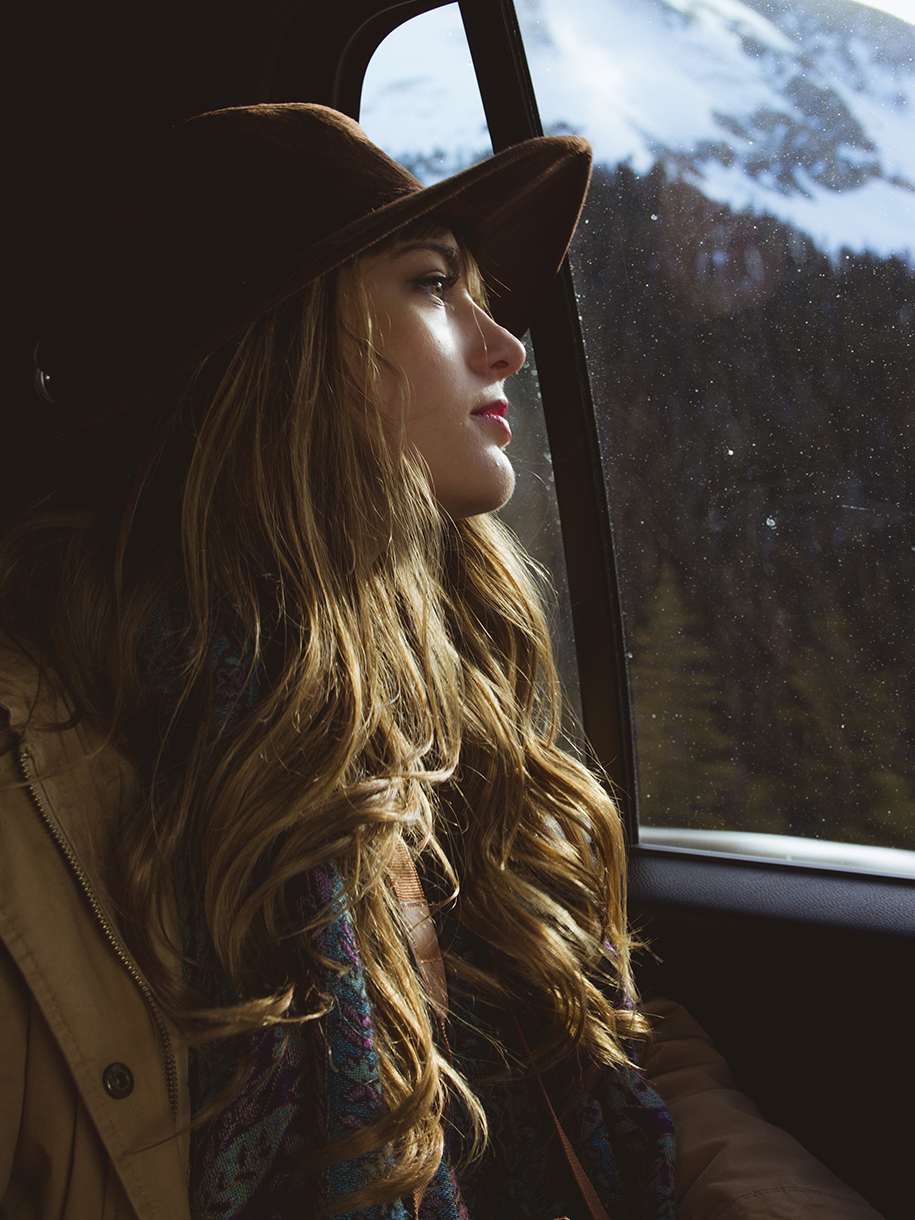 portrait of girl thinking while looking out of window