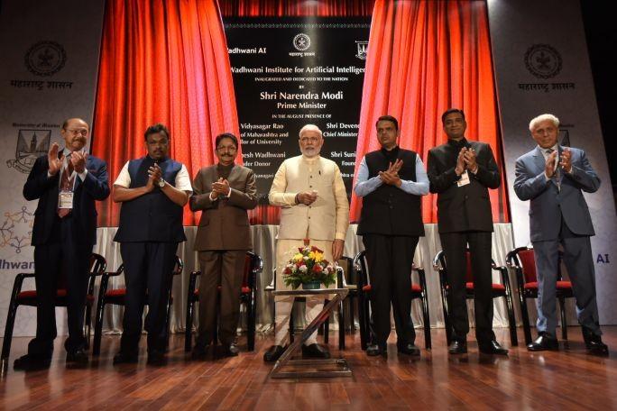 Sunil Wadhwani (extreme left) and Romesh Wadhwani (extreme right) look on as Prime Minister Narendra Modi inaugurates Wadhwani AI. (Image source: narendramodi.in)