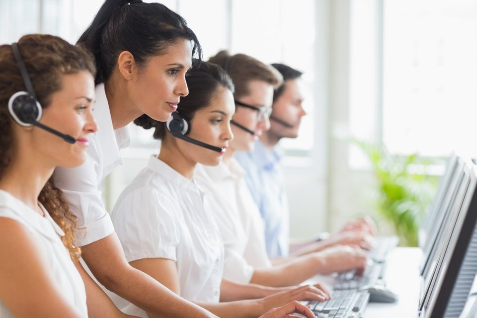 Side view of female manager assisting her staffs in a call center-2.jpeg