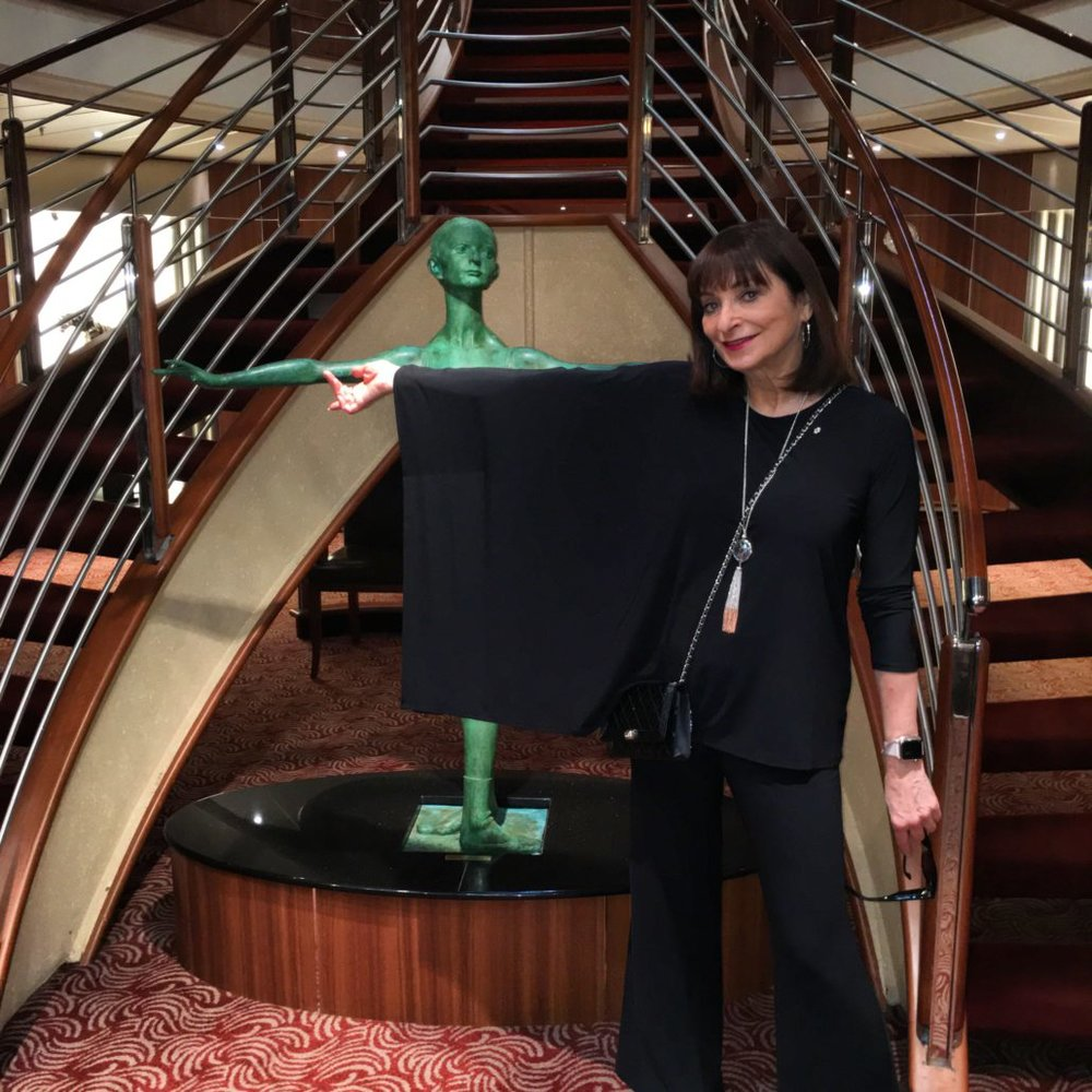Relaxed chic is the way to go! It's always fun to dress for dinner, and the variety of fine dining experiences on board is brilliant. The stellar interior of this magnificent ship is a constant inspiration!