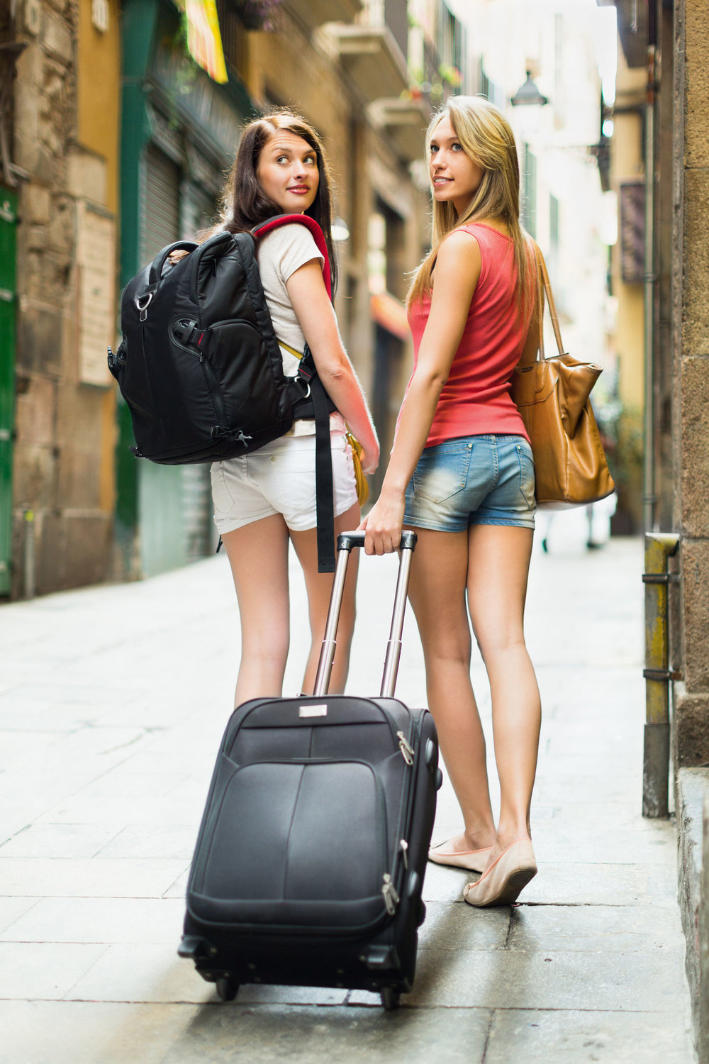 "href=""https://www.freepik.com/free-photo/two-beautiful-women-with-luggage_1474420.htm  Designed by Freepik"