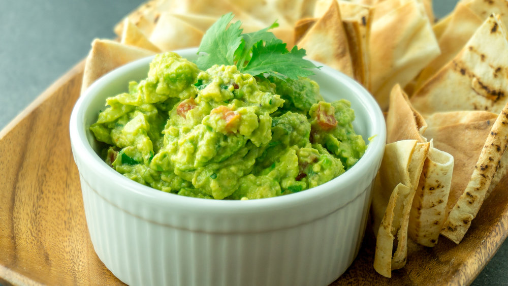 guacamole - 3 avocados (peeled, pitted, and mashed)1 lime (juiced)1 teaspoon salt½ cup onion (diced)3 tablespoons fresh cilantro (chopped)2 roma tomatoes (diced)1 teaspoon garlic (minced)1 pinch ground cayenne pepper (optional)Directions:In a medium bowl, mash together the avocados, lime juice, and salt. Mix in onion, cilantro, tomatoes, and garlic. Stir in cayenne pepper. Refrigerate 1 hour for best flavor, or serve immediately. Eat with favorite pita or tortilla chips!