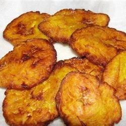fried plantains - 2 cups olive oil (for frying)3 plantains (peeled and sliced into 1-inch pieces)to taste sea saltto taste garlic powderDirections:Heat the oil in a heavy skillet over medium heat. Place a few plantain slices in the oil, and cook until lightly golden in color, about three minutes. Drain on paper towels. Repeat with the remaining slices.While the plantain slices are still warm, place them one at a time between two sheets of wax paper, and flatten by hand to 1/4 inch thick. Return flattened slices to the skillet, and continue frying until golden brown. Drain on paper towels, and season with sea salt and garlic powder.