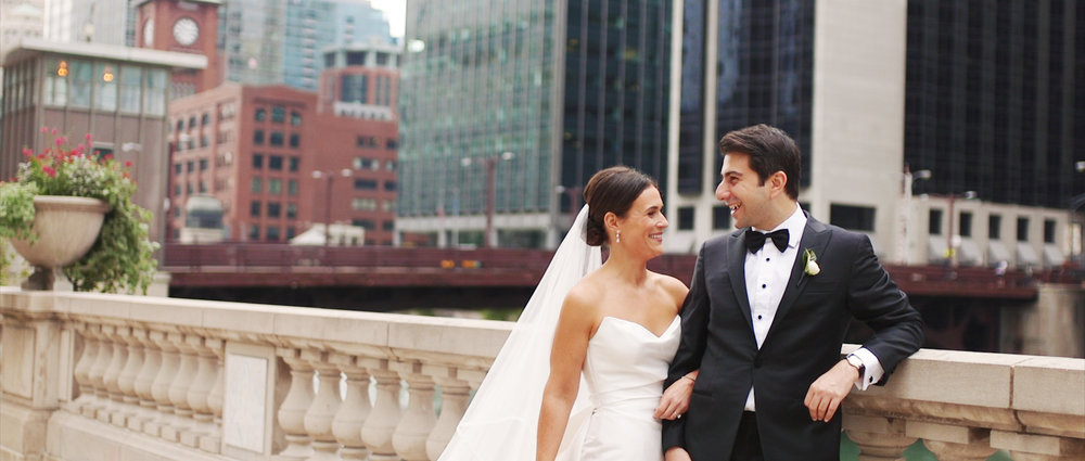 Bride and groom at the Chicago Riverwalk on their wedding day. Their reception was at Revel Motor Row.