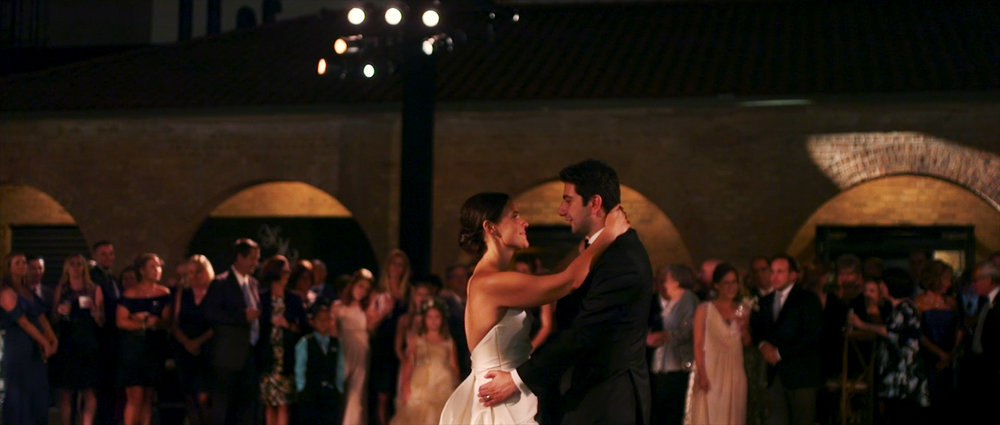 Bride and groom dance at their Chicago Wedding - Revel Motor Row Wedding Video