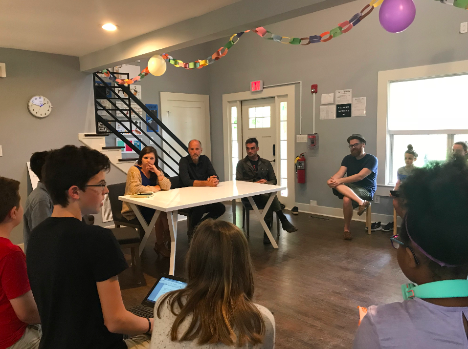 """Learners (ie """"Consultants"""") from the Middle School Studio pictured above empathizing with leaders of  Pinewood Forest  (ie """"Clients"""") to understand their challenges and desires regarding the Pinewood Forest Spring Marketfest."""