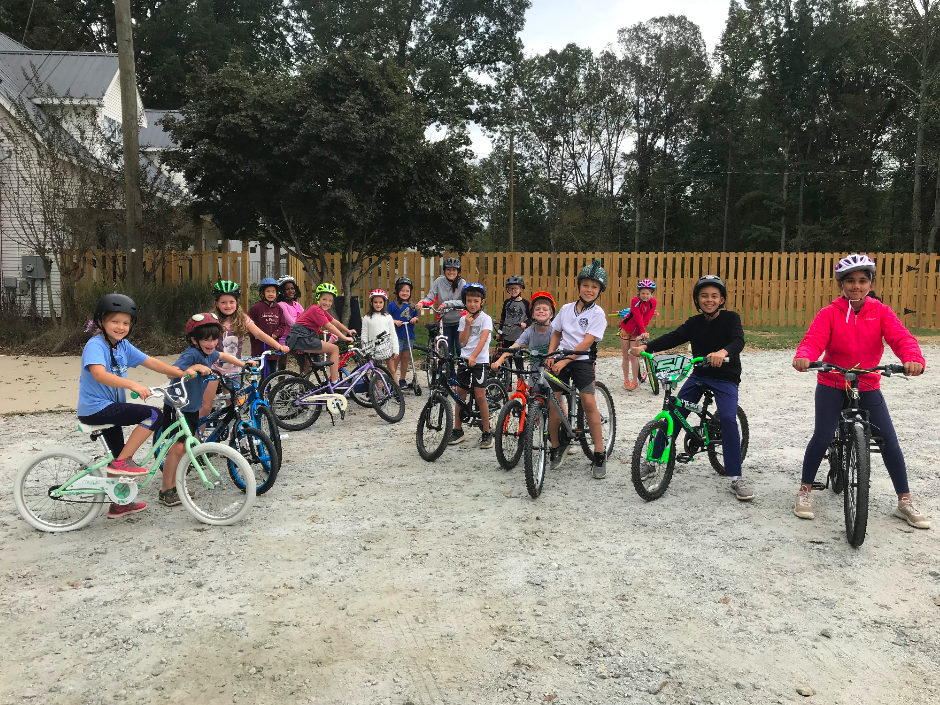Our elementary learners preparing for their bike tour of Pinewood Forest