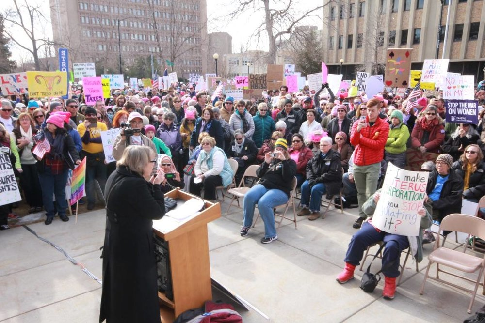 Representative Cathy Connolly, Ph.D., J.D. (Laramie - HD13) was our keynote speaker in the first Women's March Wyoming. She has served as the Director of Women's Studies from 2000-06, and from 2013-16.  She has adjunct appointments with American Studies and Disability Studies and helped to establish the Queer Studies minor.  In her work, she has won numerous recognitions for outstanding teaching and advising.  She was the first openly gay Wyoming state legislator and continues to be a champion for Wyoming's working women and families.