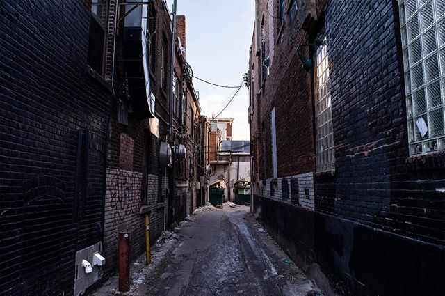the alley between St. Burch Tavern and Basta Pizzeria Ristorante . . . . . . . . #streetphotography #alley #iowacity #urban #industrial #industry