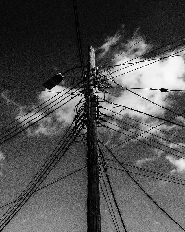 Noise from a source . . . . . . . . #streetphotography #electricity #proxy #for #evil #garmonbozia #source #dimensions #light #lightpole #photo #powerlines #are #my #shit