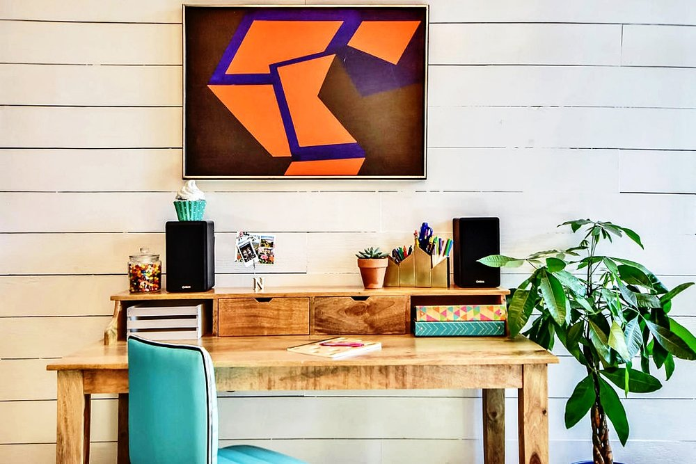 A stunning, colorful piece of wall art is sure to add interest to any room. Bringing guests attention to a piece of art is a great way to portray your style and personality.