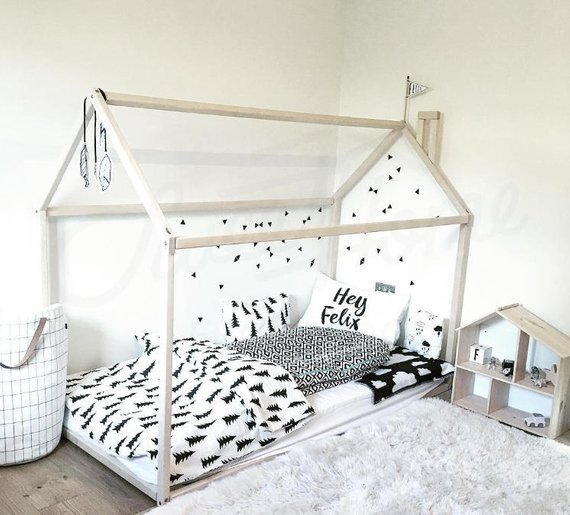 For the Itty Bitties in Your Life - There is nothing sweeter than a child's space and yet as they grow the demands can too quickly get serious. Keep things soft with this very cozy little bed frame from Etsy's SweetHomeFromWood.
