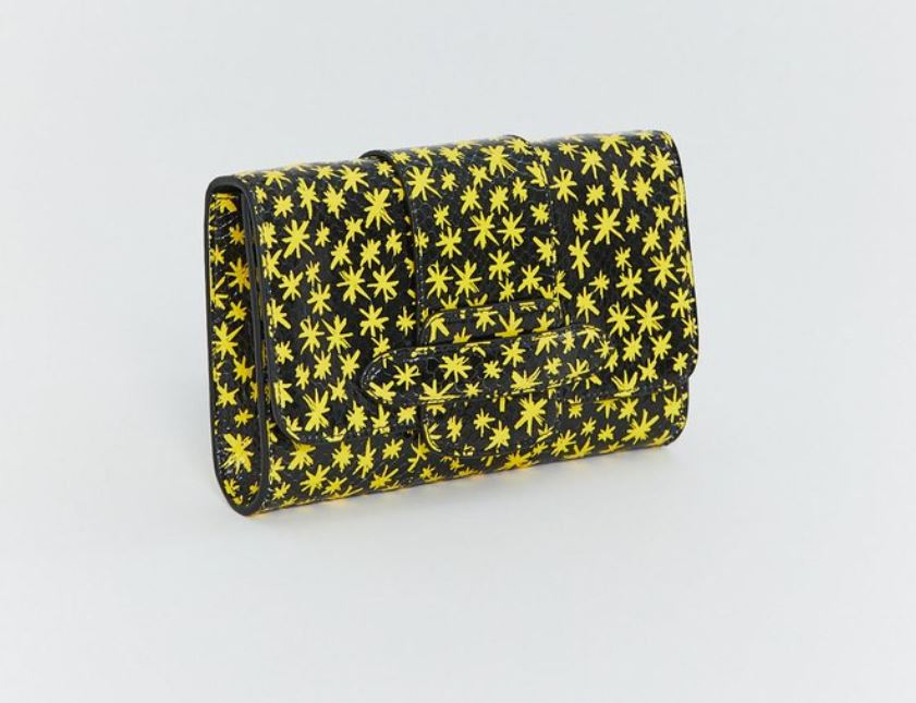 For Mom (Your Very Cool Mom) - As you know, I never shy away from color, so on any uninspired outfit night, you can count on a bold clutch to help you get it right. That's a great sentiment to send upstream. Enhance your mother's natural style with this brilliant and bold patterned clutch from Michino. Available here in Austin at the ever-cool Kick Pleat, this is sure to be an overused favorite for your most treasured female role model.