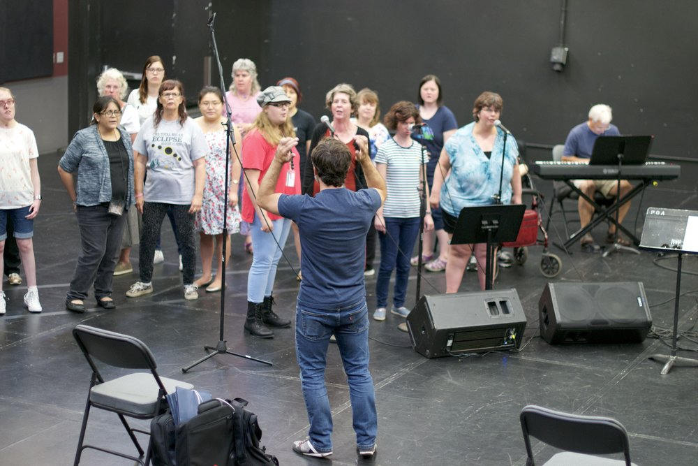 Director of Art and Education Matthew Gailey conducting sopranos and altos in the PHAME choir. Photo credit: Friderike Heuer.
