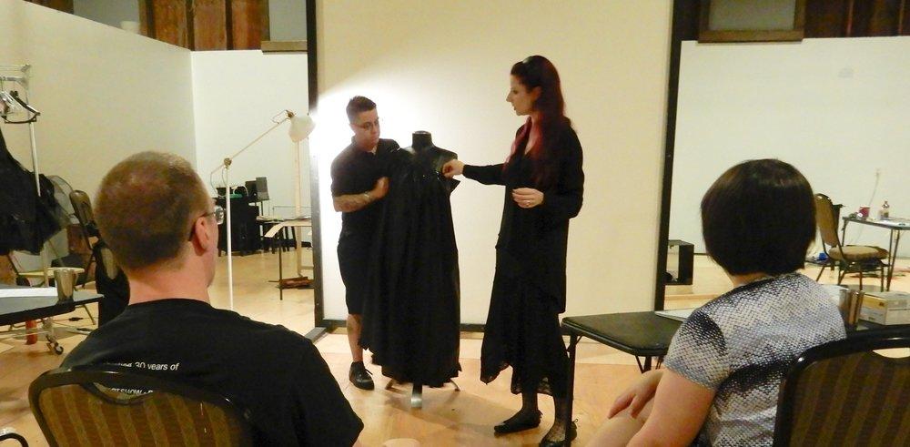 Teaching Artist Liliane Hunt demonstrates costume draping to Costume Design students. Photo credit: David Chachere.