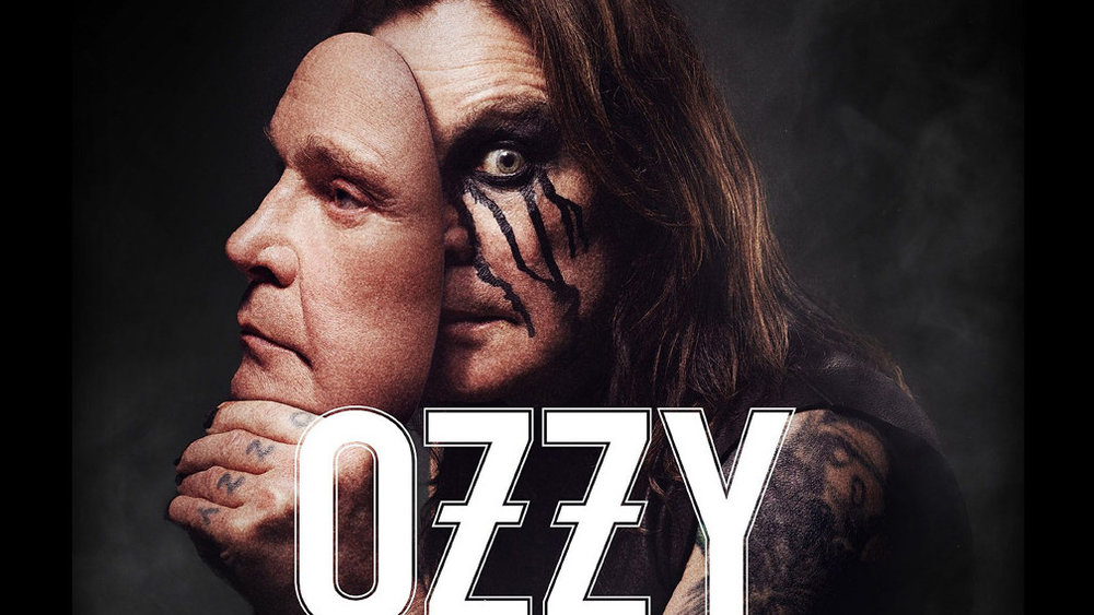 Man with black tears on his face holds a mask that looks like a real human face, the word Ozzy